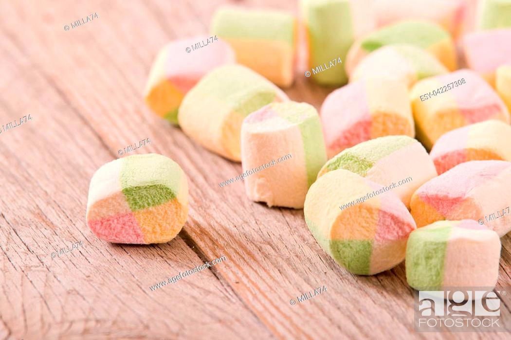 Stock Photo: Marshmallows on wooden table.