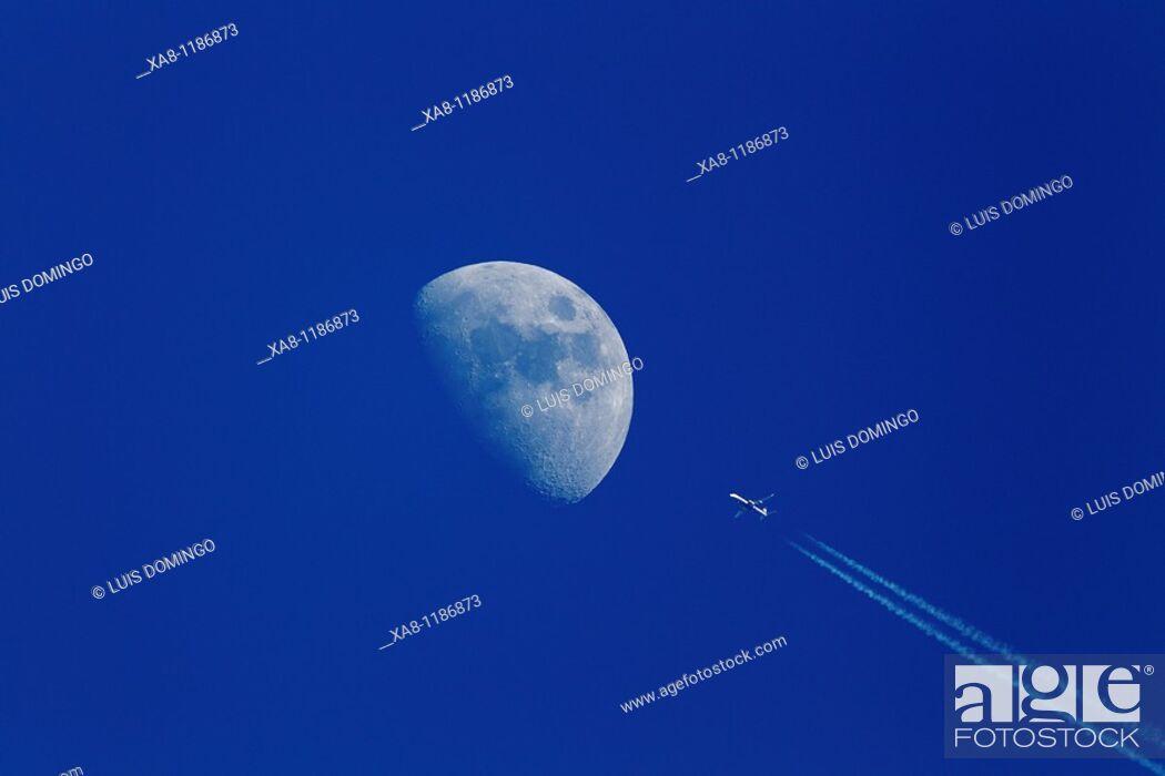 Stock Photo: Moon and plane.
