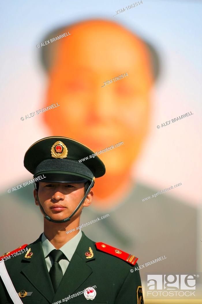 Stock Photo: Soldier in front of the huge portrait of Chairman Mao in Tianenmen Square, Beijing.