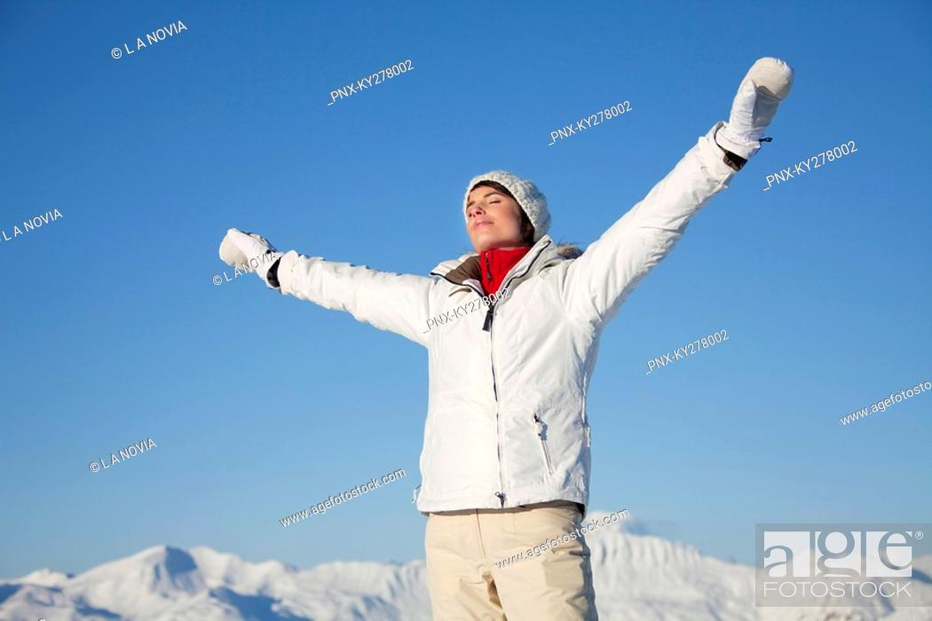 Stock Photo: Young woman breathing fresh air.