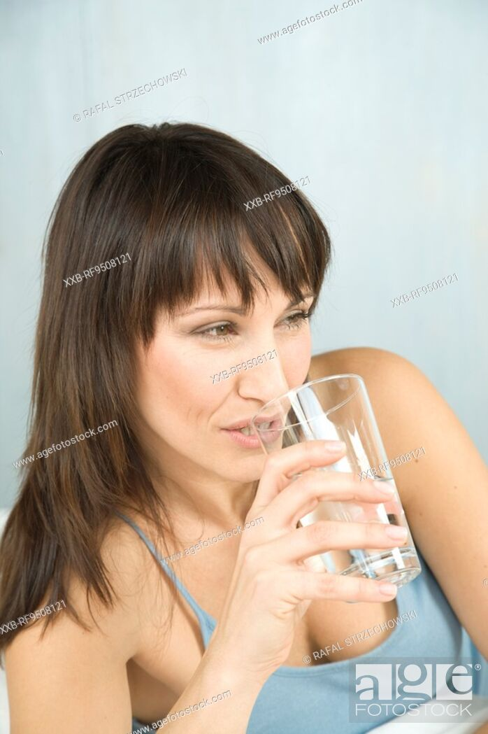 Stock Photo: owman drinking water.