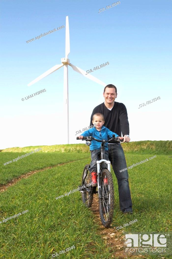 Stock Photo: Father and son on a bike.