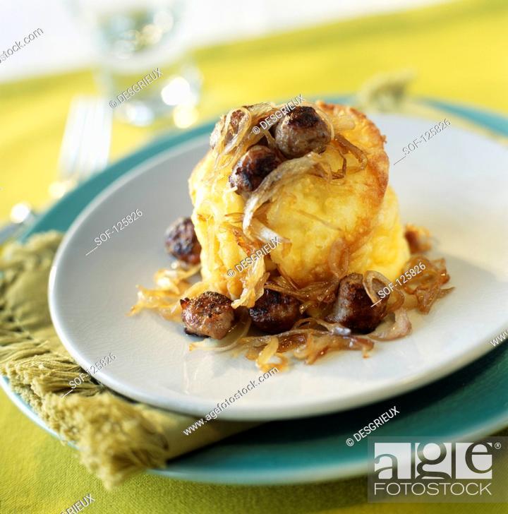 Stock Photo: Yorkshire pudding with Chipolatas.
