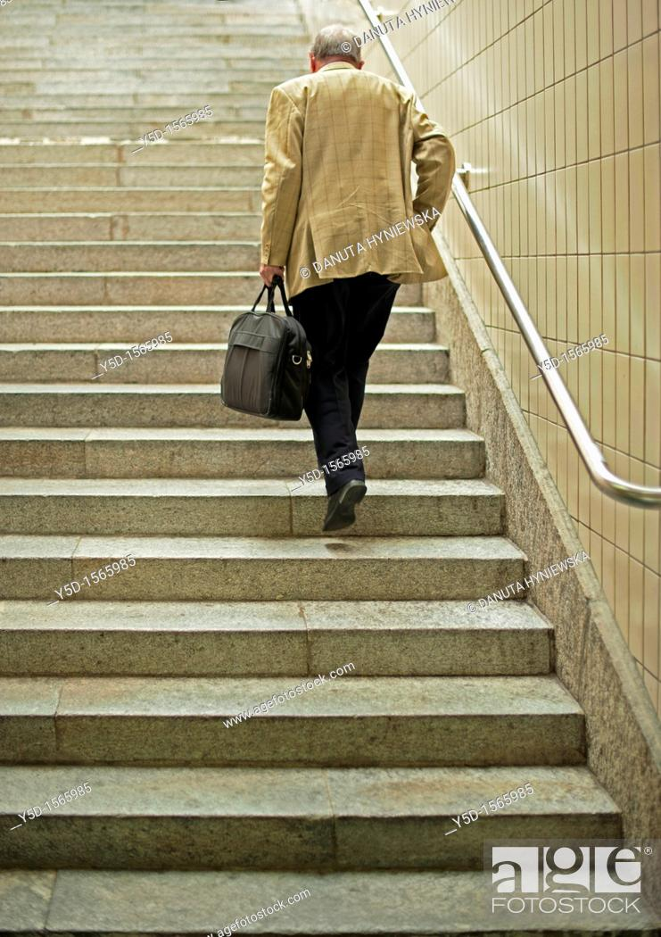 Stock Photo: lonely traveller climbing the stairs.