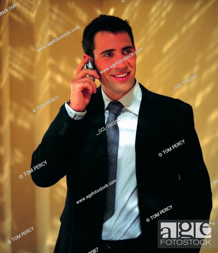 Stock Photo: Businessman using a cell phone.