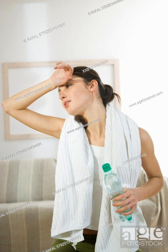 Stock Photo: tired woman after training.