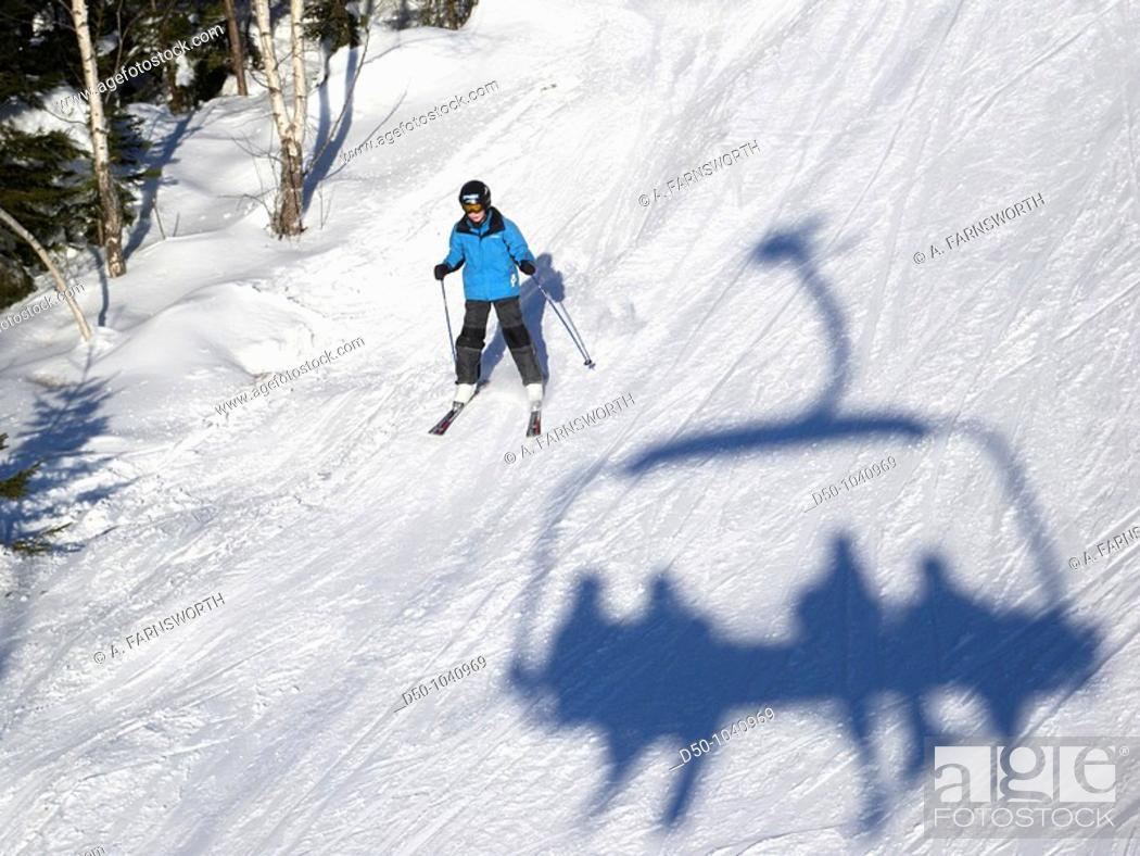 Stock Photo: Skier and shadow of chairlift at Romme Alpin Ski area in the province of Dalarna, Borlange, Sweden.