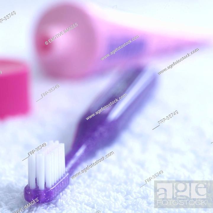 Stock Photo: purple toothbrush.