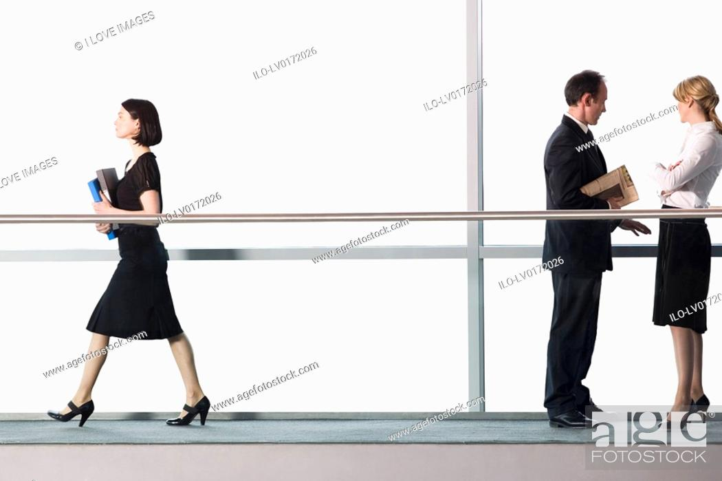 Stock Photo: Office workers in modern office building.