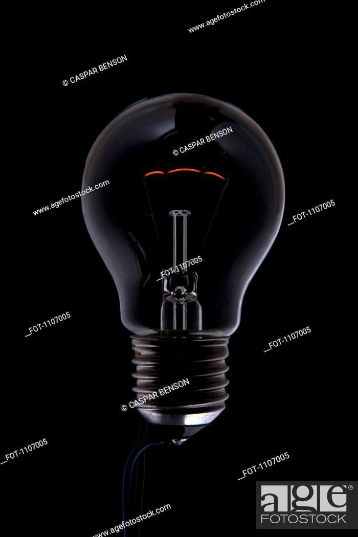 Stock Photo: An unlit light bulb in the dark.