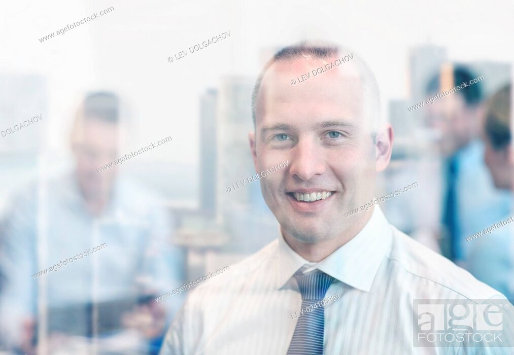 Stock Photo: business, people and teamwork concept - smiling businessman with group of businesspeople meeting in office.