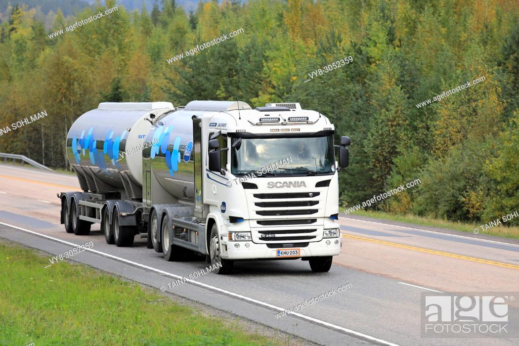 Stock Photo: Scania R450 milk tank truck transports Valio milk on highway through autumn scenery in Jamsa, Finland - September 21, 2017.