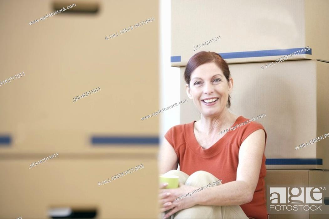 Stock Photo: Woman relaxing with coffee cup.