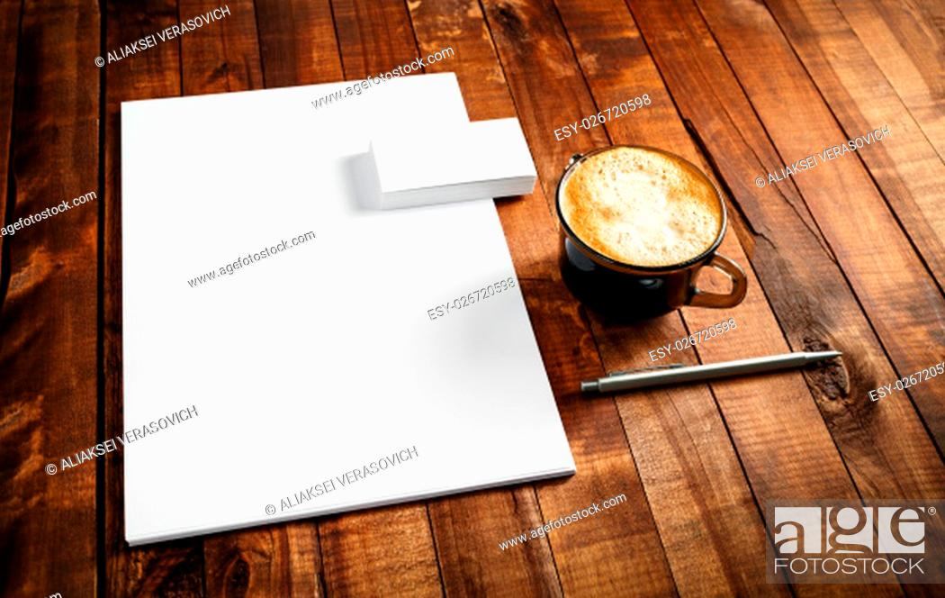 Stock Photo: Photo of blank stationery set. Corporate identity template on vintage wooden table background. Letterhead, business cards, coffee cup and pen.