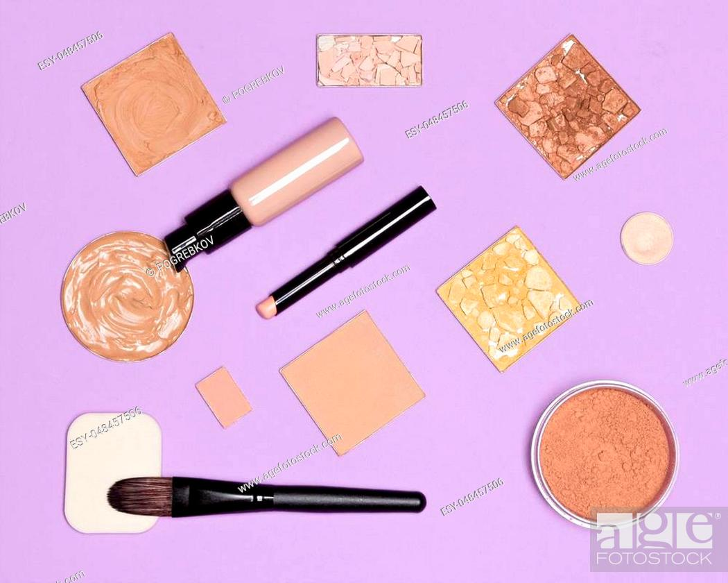 Stock Photo: Makeup cosmetics for the perfect complexion, flat lay set. Concealer pencil, foundation fluid with bronzing, highlighting, shimmer golden powder.