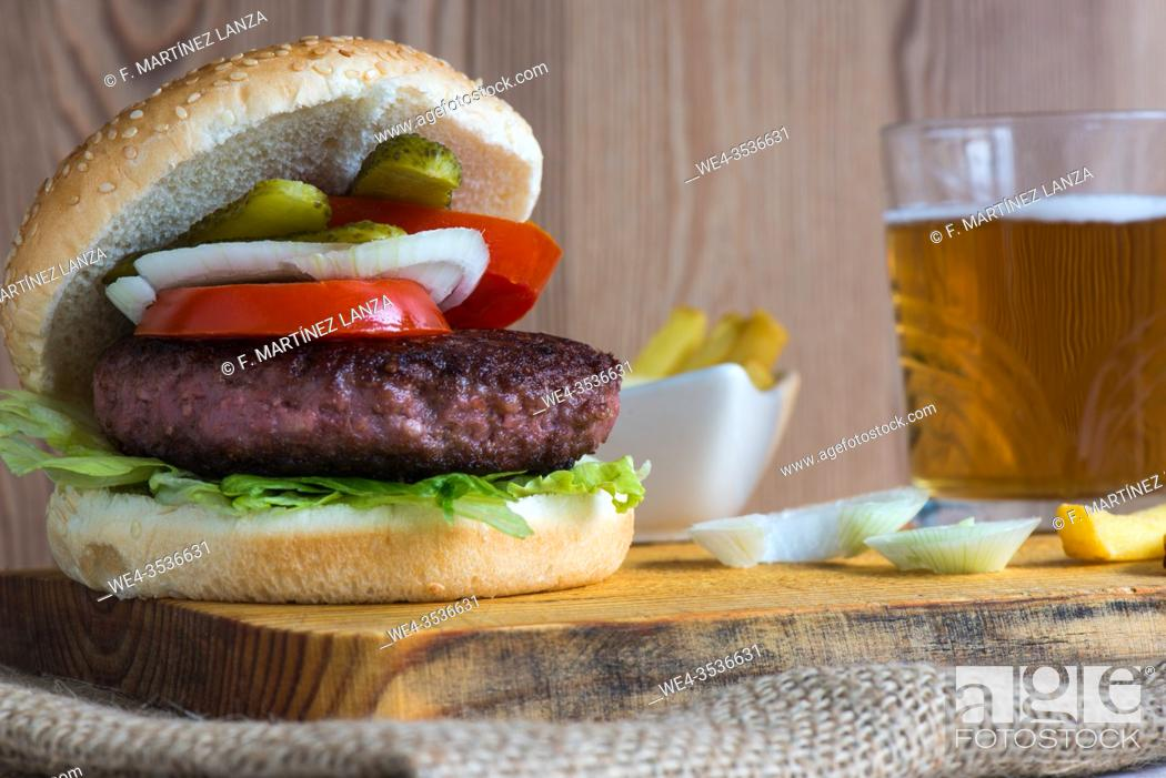Stock Photo: Beef burger with fries and beer.