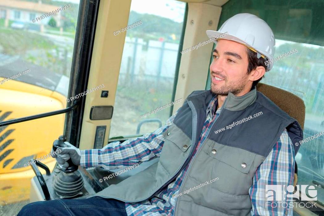 Stock Photo: heavy equipment driver.