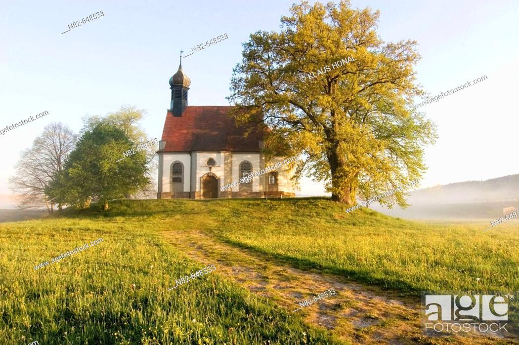 Stock Photo: Small chapel on hill at foggy morning in spring. Franconia, Bavaria / Germany.