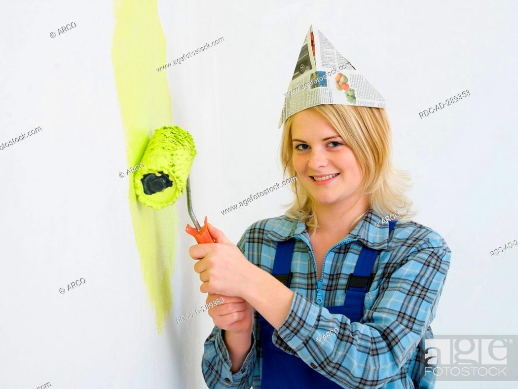 Stock Photo: painter woman with a paint roller.