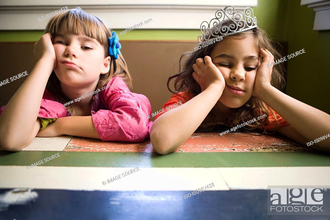 Stock Photo: Two girls, one wearing tiara.