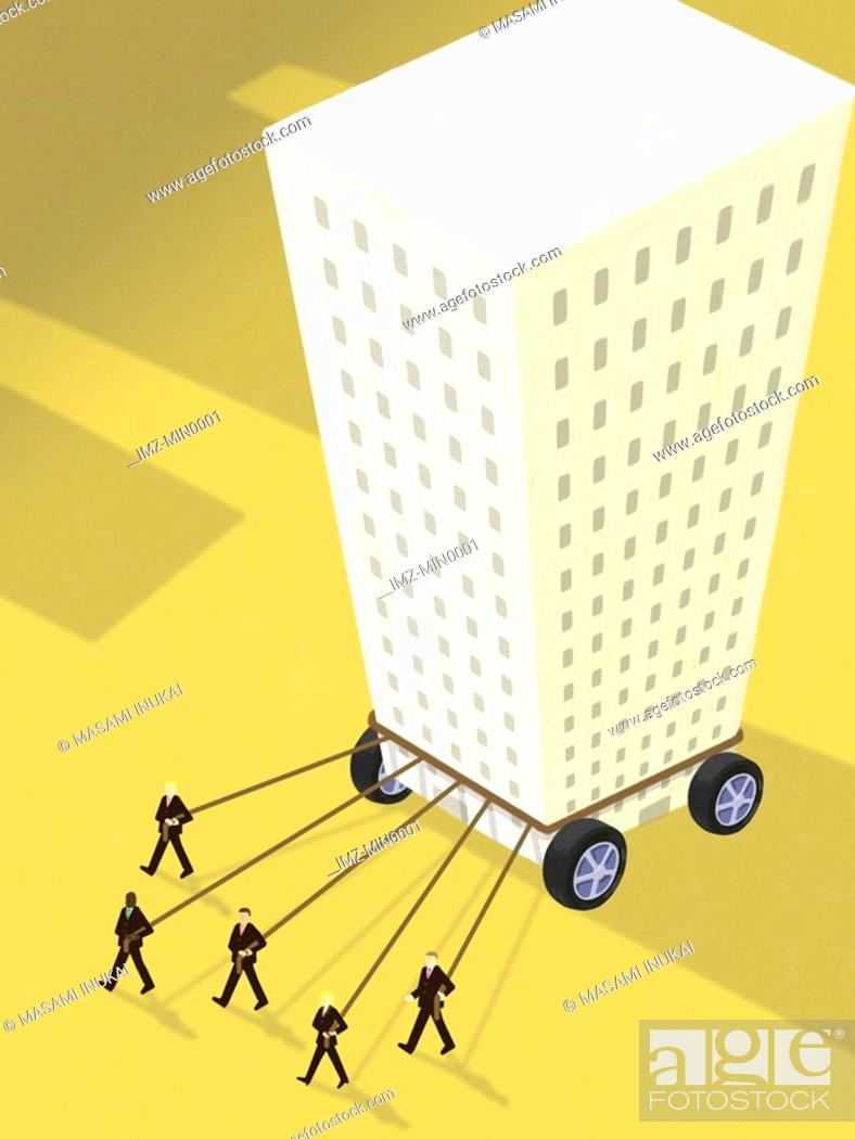 Stock Photo: Businessmen pulling ropes tied to a highrise building on wheels.