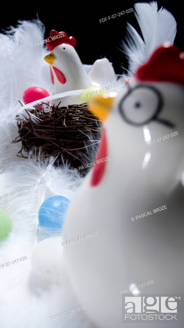 Stock Photo: Two Easter chickens and Easter eggs with feathers.