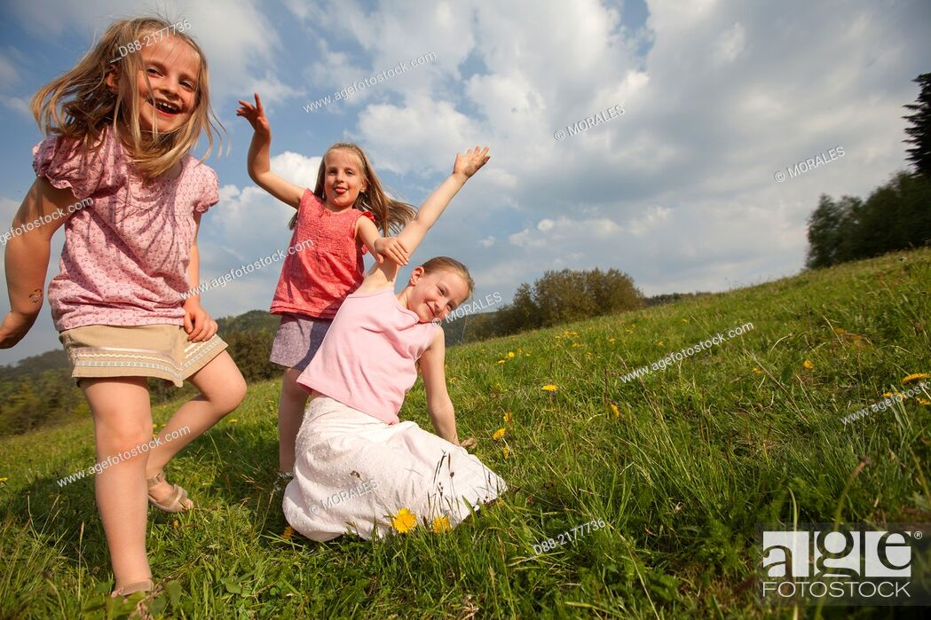 Stock Photo: France, Bas Rhin, Urbeis near the Climont, girls in a meadow.