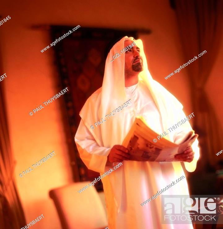 Stock Photo: Arab man holding a newspaper.