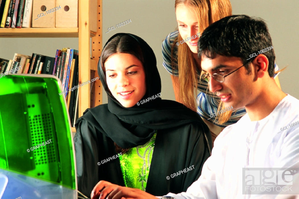 Stock Photo: Study group in front of computer.