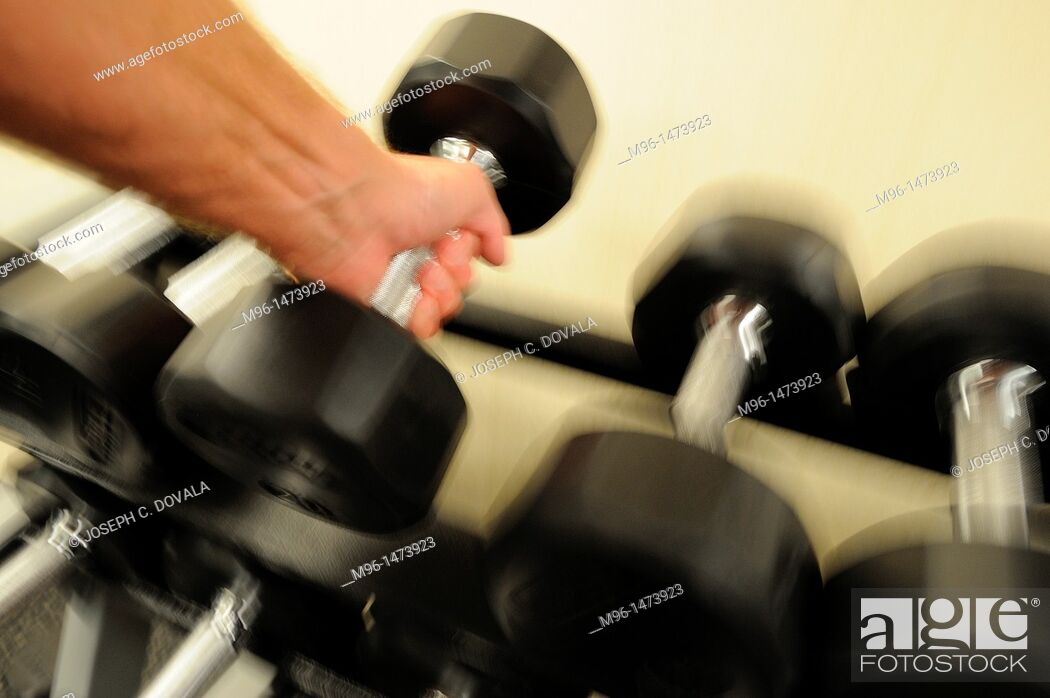Stock Photo: Male lifting dumbell, motion.