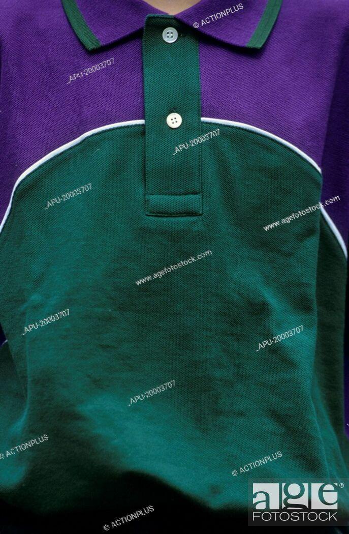 Stock Photo: Ball boy wearing a Wimbledon official shirt.