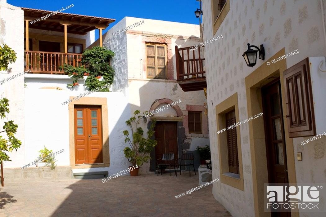 Stock Photo: Courtyard of buildings, Patmos, Dodecanese Islands, Greece.