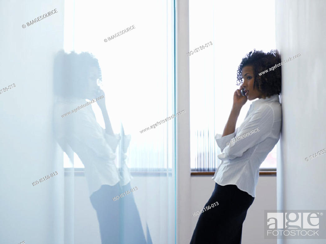 Stock Photo: Woman using mobile phone.