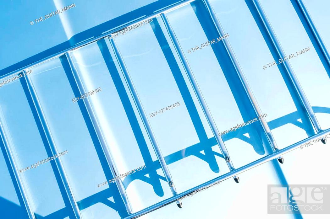 Stock Photo: abstract of shadows on a metal frame in strong sunlight.