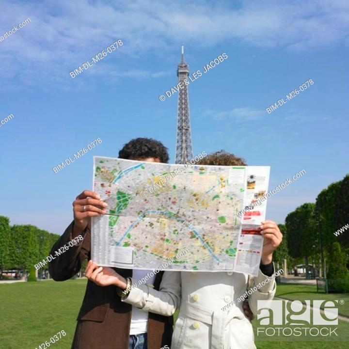 Stock Photo: Couple looking at map in urban park.