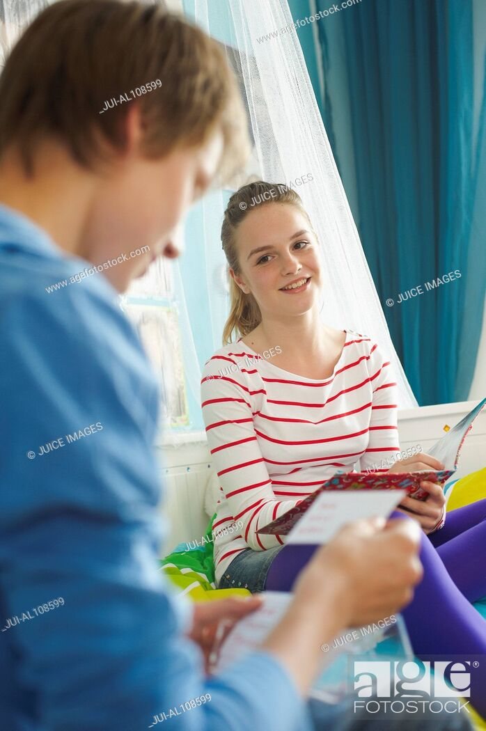 Stock Photo: Young boy and girl reading together.