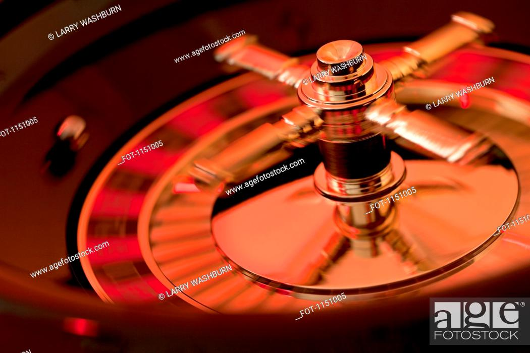 Stock Photo: A spinning roulette wheel.