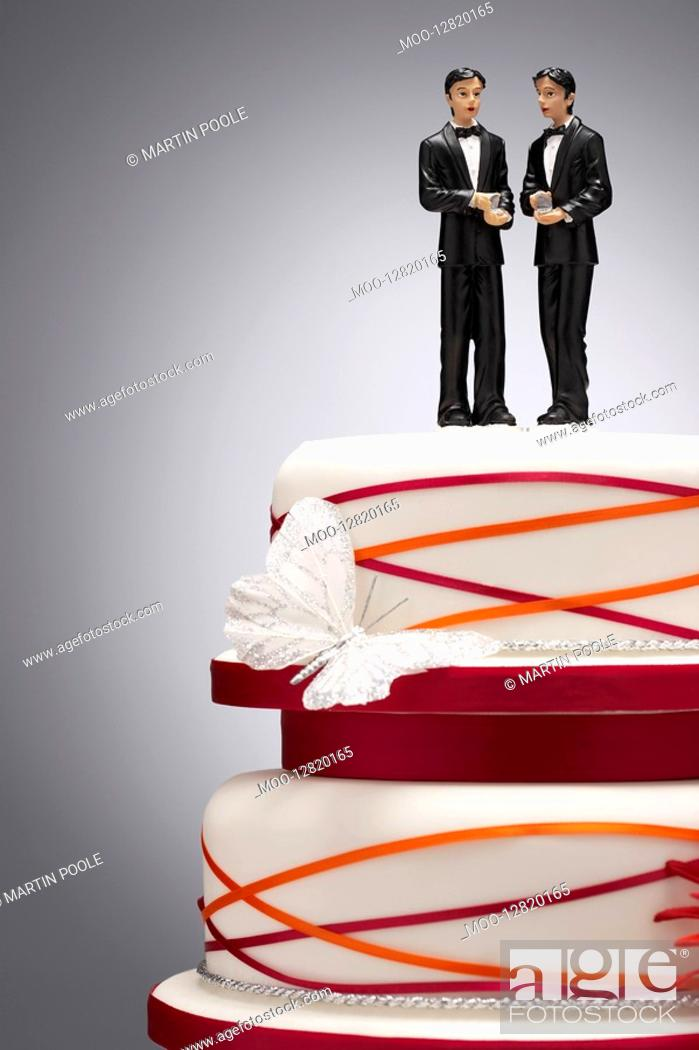 Stock Photo: Groom Figurines on Wedding Cake.