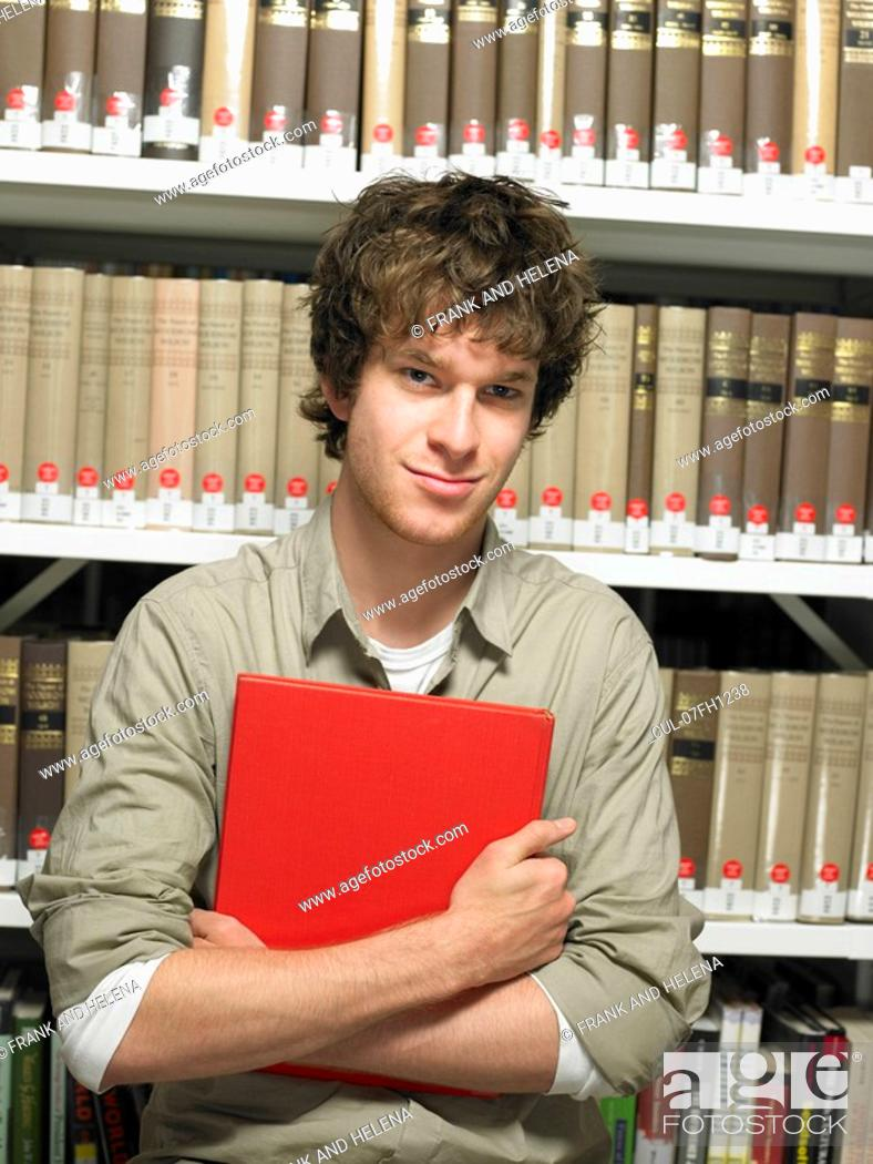 Stock Photo: Portrait of young man with book.