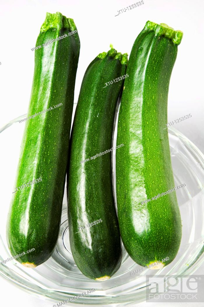 Stock Photo: Three Courgettes in a Glass Bowl.
