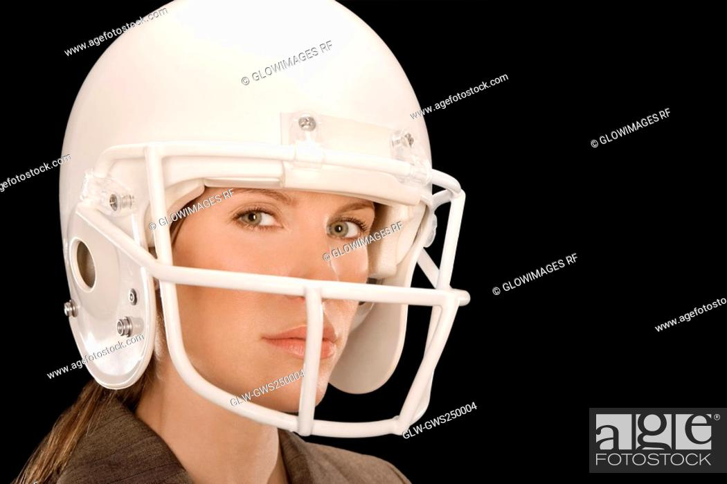 Stock Photo: Close-up of a businesswoman wearing a football helmet.