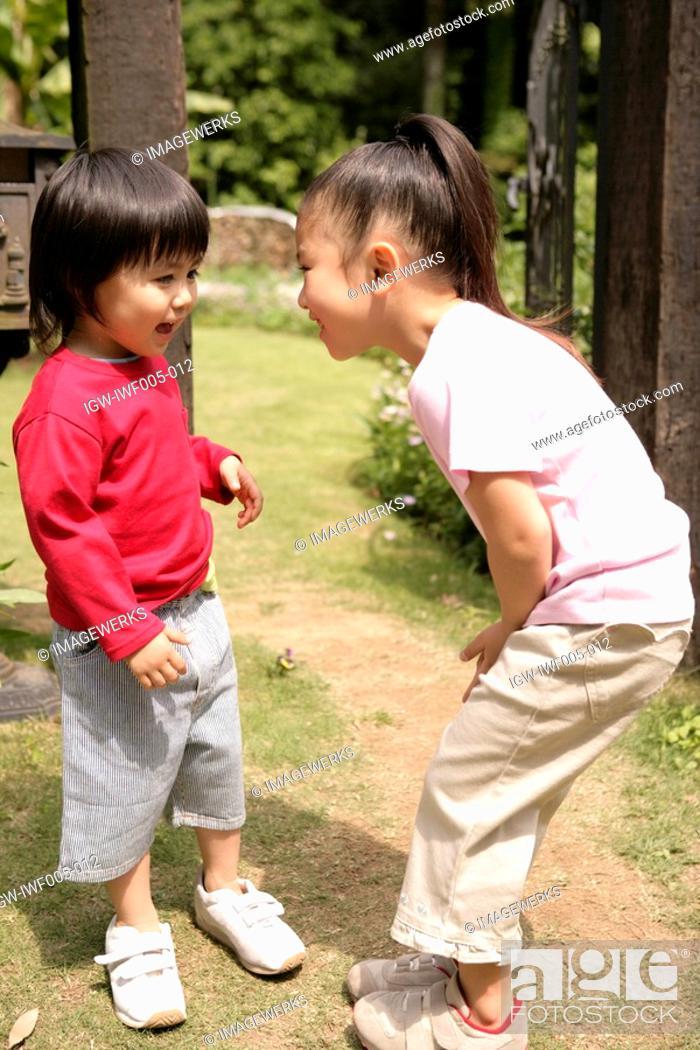Stock Photo: Two children enjoying themselves in the garden.