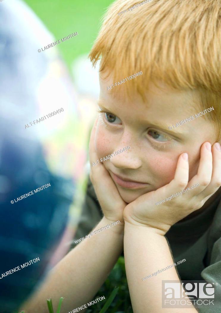 Stock Photo: Boy looking at globe.
