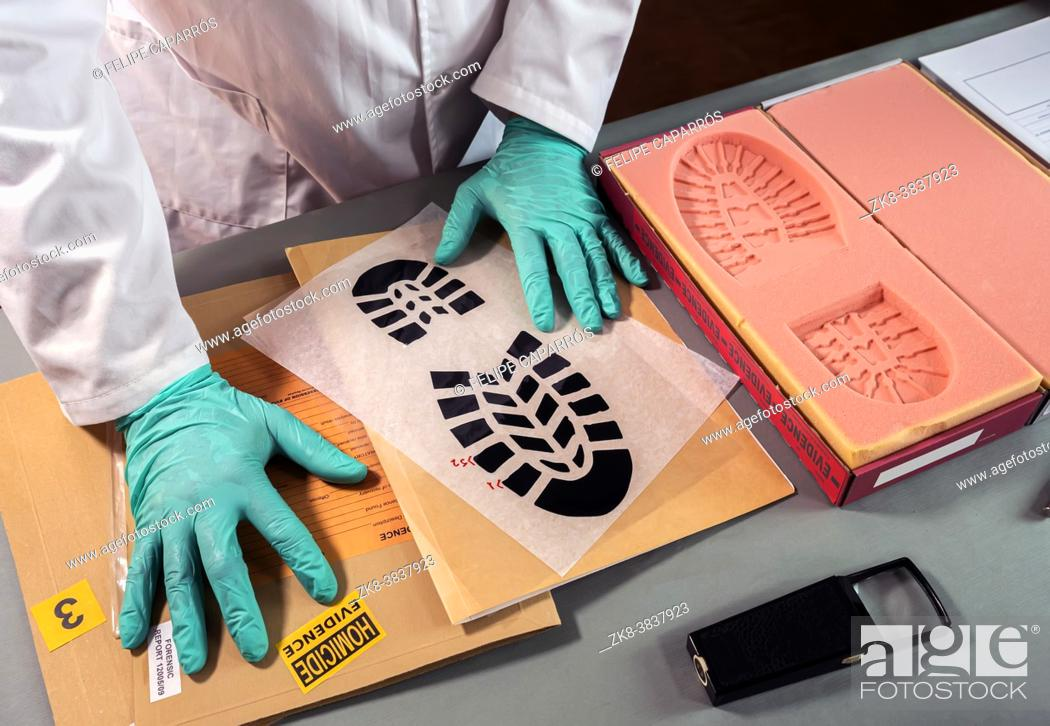 Photo de stock: Forensic scientist impatient because he can't find similarity in shoe sole prints in crime lab, concept image.