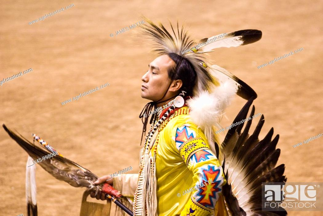 Stock Photo: American Lakota Indian warrior in traditional ceremonial oufit at pow-wow.