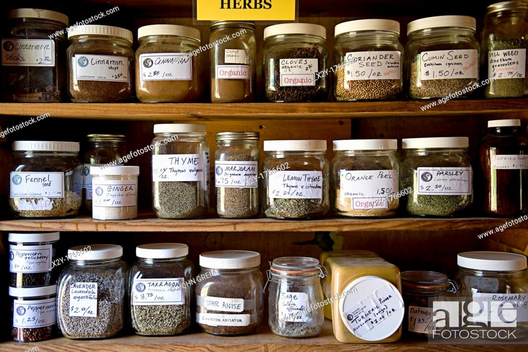 Stock Photo: Jars containing herbs in ahelth food store.