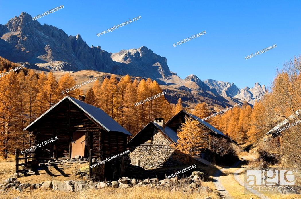 Stock Photo: France, Hautes Alpes, the Brianconnais area in autumn, La Claree Valley, typical chalets with larch shingle roofs.