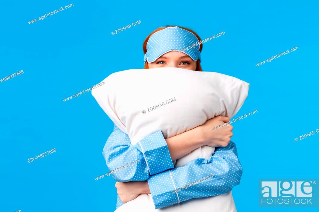 Stock Photo: Lovely and sensual, tender cute redhead woman in nightwear, teen girl hugging pillow and smiling, squinting camera silly, like sleeping love bed.