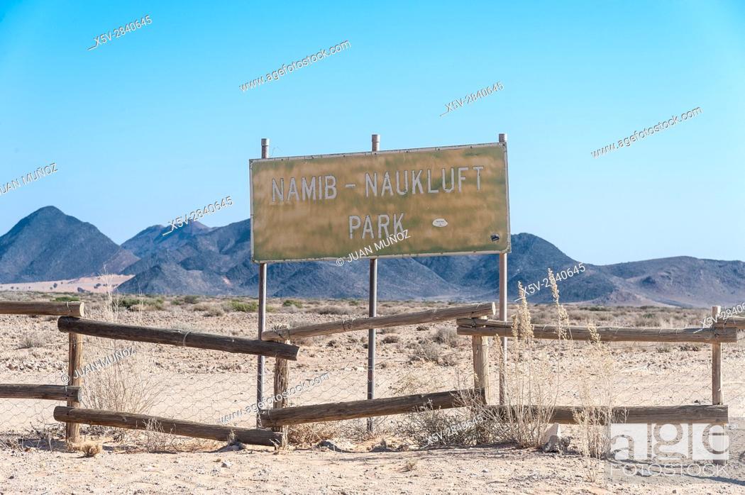 Stock Photo: Poster and fence bordering the Namib-Naukluft National Park. Namibia.