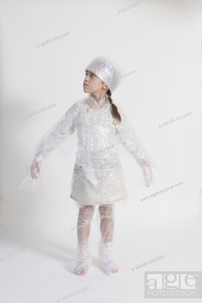 Stock Photo: little girl wearing bubble wrap.